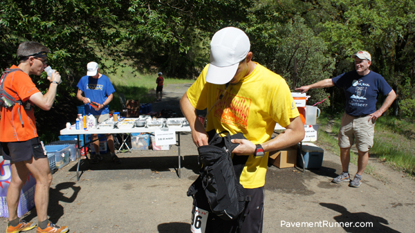 Checking supplies at the mile 38 aid station.