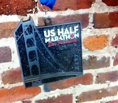 Still image form a Instagram video of the 2013 finisher medal.