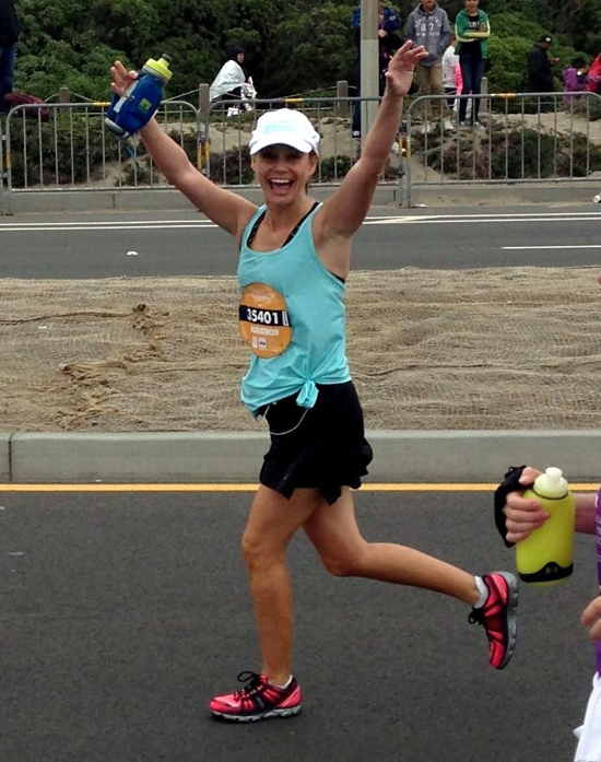Seconds before crossing the finish line of my first full marathon. Life-changing!