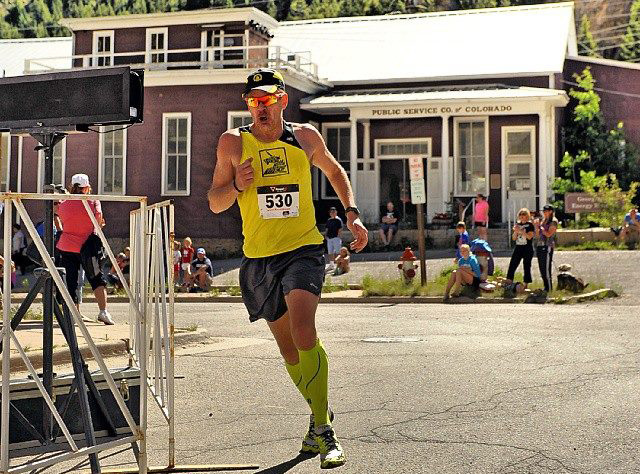 Turning the corner towards the finish line at the Slacker Half Marathon in Colorado with my first sub-1:30 half and PR. — SeekingBostonMarathon.com