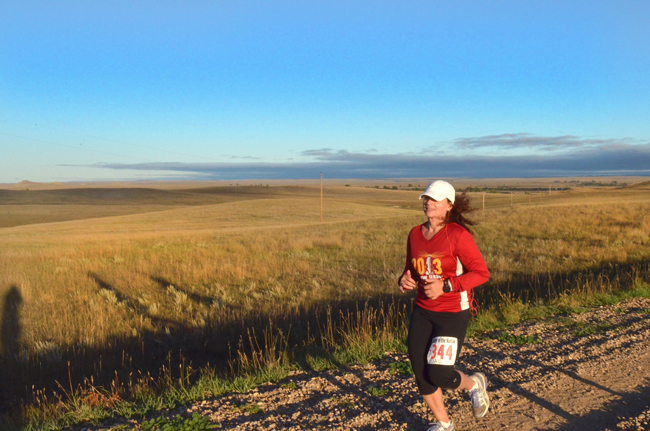 This is me running my 4th of 5 consecutive half-marathons in 5 days (in 5 states). This was on a ranch in Albion, Montana. Photo taken/permission given by Timothy Nohe. — http://www.sweatoutthesmallstuff.com