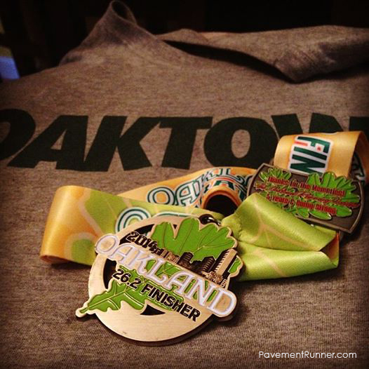 2014 Finisher medal and bonus 5th year runner hardware.