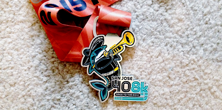 The 408k finisher's medal (and bottle opener) — yes, that is a mariachi shark.