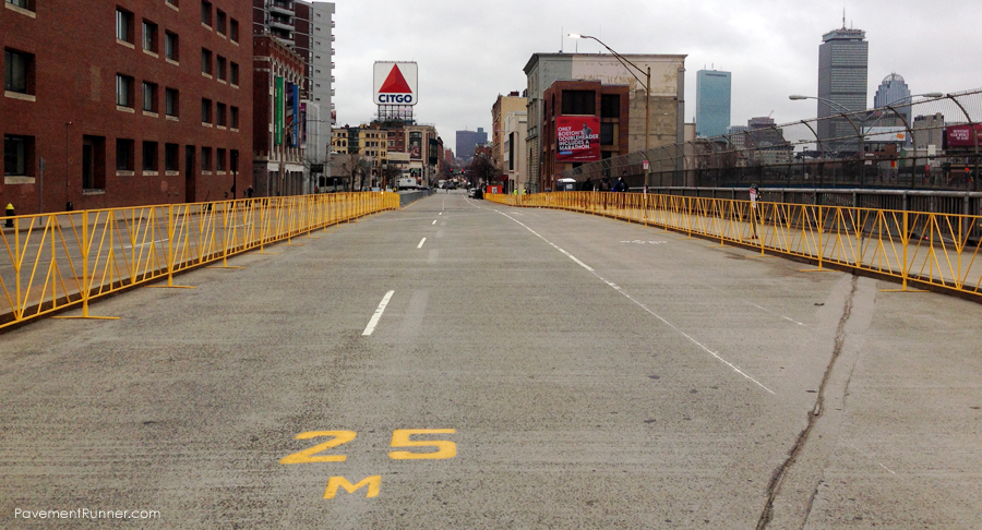 "Iconic CITGO sign and the ""one mile to go"" marker of the Boston Marathon."